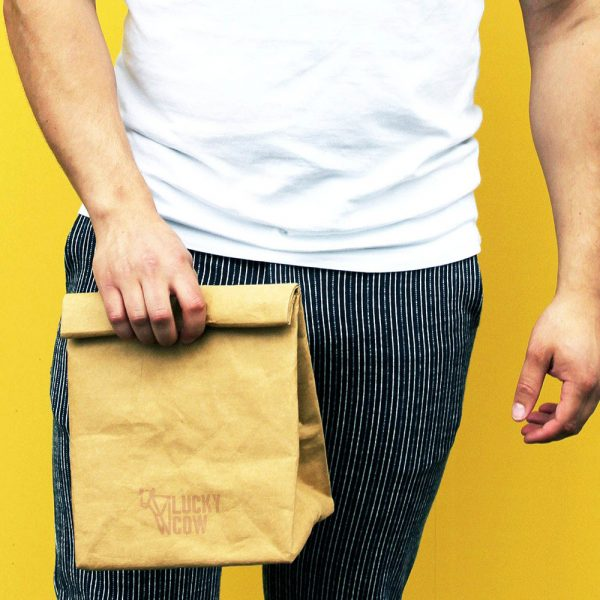 lucky cow paper lunch bag being carried