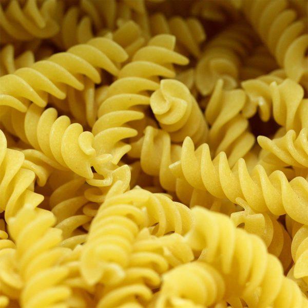 uncooked white fusilli pasta